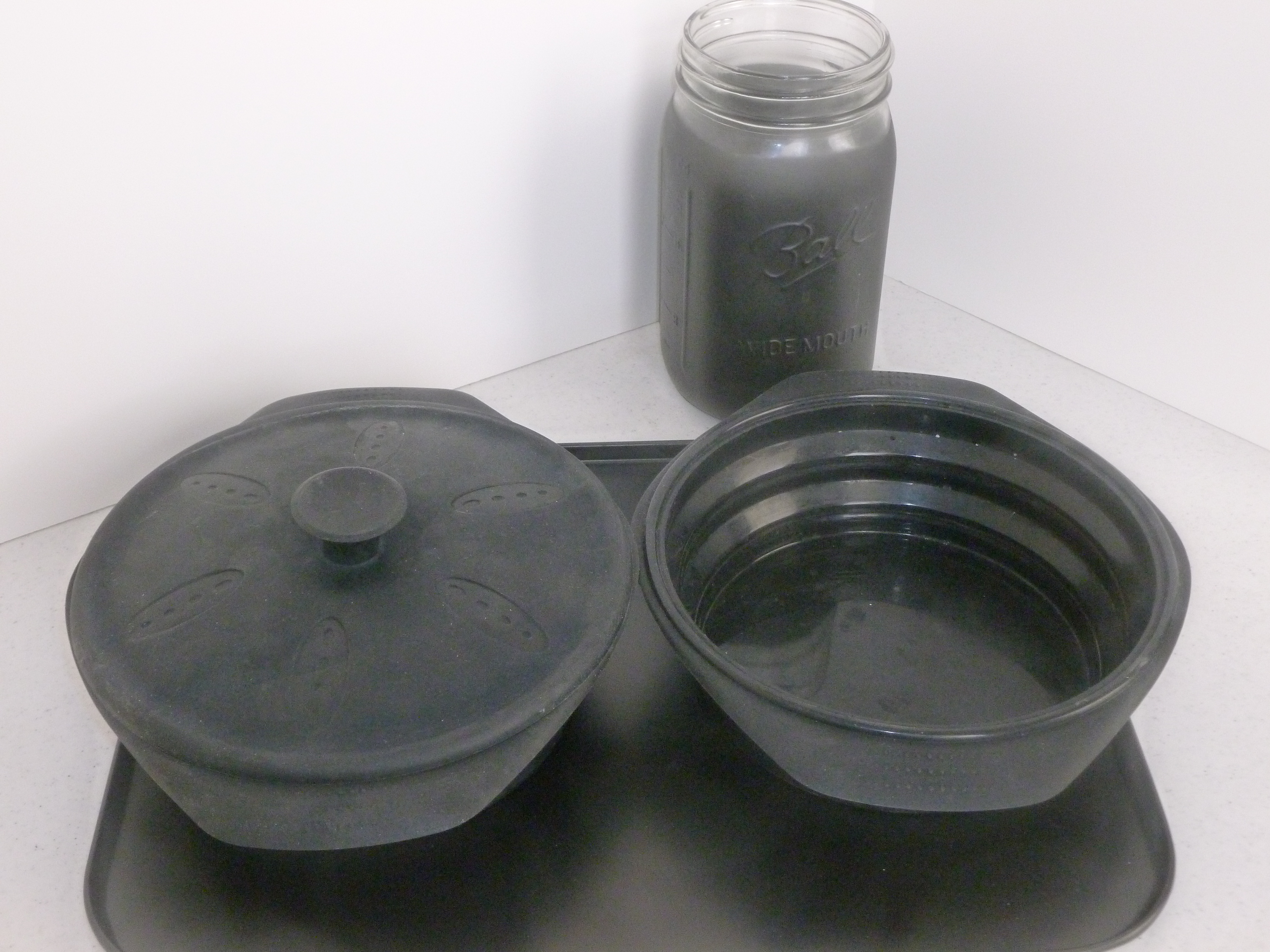 Black Silicon pots, black cookie sheet, black painted canning jar Cookware Guide for solar oven cooking